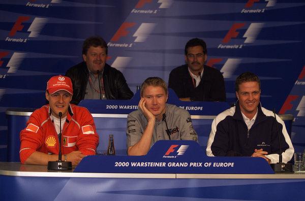 2000 European Grand Prix.Nurburgring, Germany. 19-21 May 2000.Mika Hakkinen (McLaren Mercedes) in between Michael Schumacher (Ferrari) and Ralf Schumacher (Williams BMW) at a press conference.18mb DigitalWorld Copyright - LAT Photographic