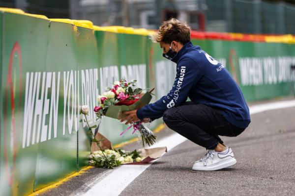 Pierre Gasly, Toro Rosso, lays flowers in memory of Anthoine Hubert