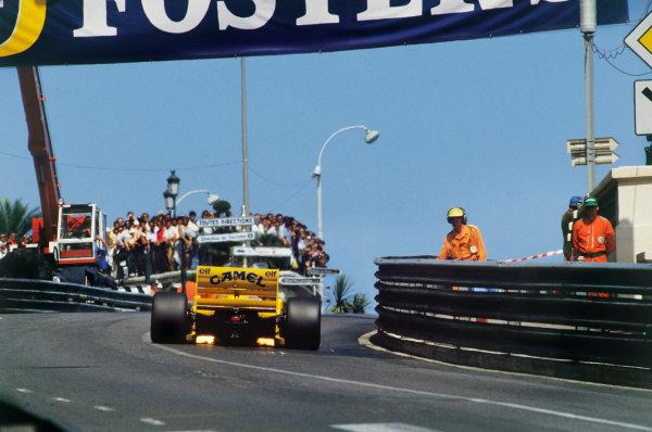 1987 Monaco Grand Prix. Monte Carlo, Monaco. 28th - 31st May 1987.  Ayrton Senna (Lotus 99T Honda),1st position, action.Ref: 87MON53. World Copyright - LAT Photographic