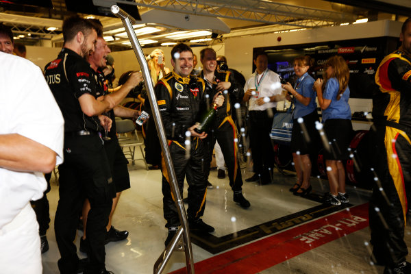 Yas Marina Circuit, Abu Dhabi, United Arab Emirates Sunday 4th November 2012. The Lotus team celebrate victory. World Copyright: Andrew Ferraro/  ref: Digital Image _79P3980
