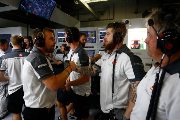 Suzuka Circuit, Japan. Saturday 8 October 2016. Haas F1 engineers celebrate a successful qualifying session. World Copyright: Andrew Hone/LAT Photographic ref: Digital Image _ONZ4664