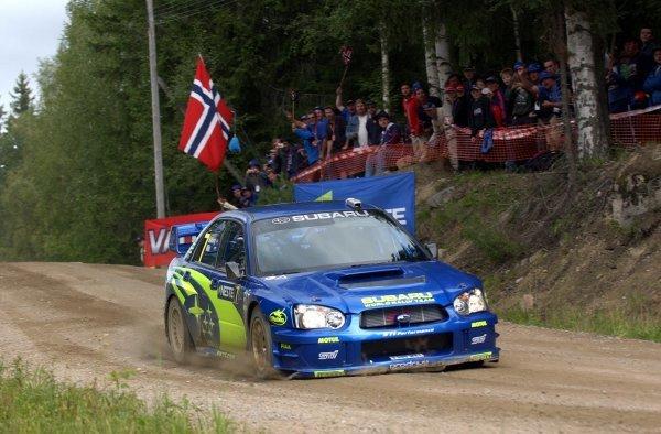 Petter Solberg (NOR) lands heavily in his Subaru Impreza WRC 2003.FIA World Rally Championship, Rd9, Neste Rally Finland, Jyvaskyla, Finland, Day 3, 10 August 2003.DIGITAL IMAGE
