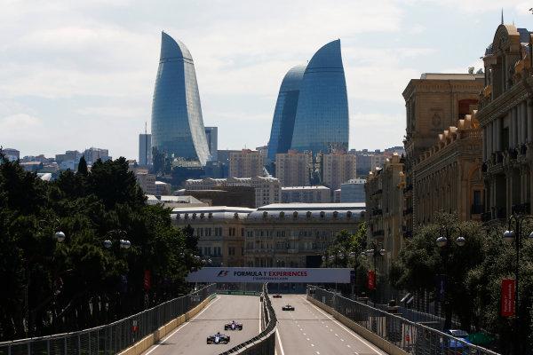 Baku City Circuit, Baku, Azerbaijan. Friday 23 June 2017. Marcus Ericsson, Sauber C36 Ferrari, leads Carlos Sainz Jr, Toro Rosso STR12 Renault. World Copyright: Andrew Hone/LAT Images ref: Digital Image _ONY8496