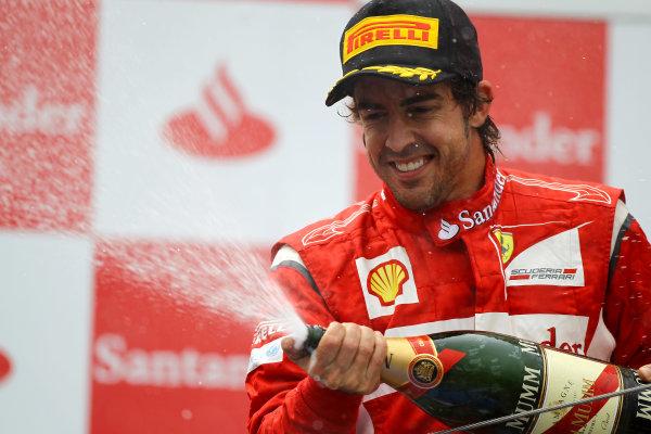Nurburgring, Germany.24th July 2011Fernando Alonso, Ferrari 150° Italia, 2nd position, sprays the Champagne. Portrait. Podium. World Copyright: Andy Hone/LAT Photographicref: Digital Image CSP13488