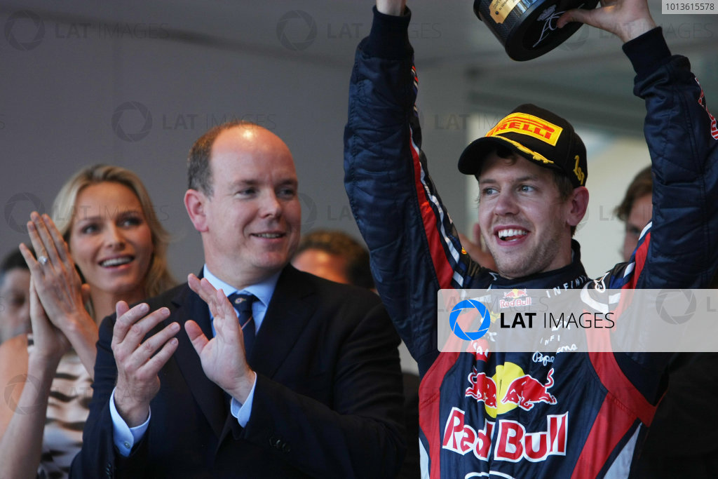 Monte Carlo, Monaco 29th May 2011 Sebastian Vettel, Red Bull Racing RB7 Renault, 1st position, lifts his trophy alongside Prince Albert and Charlene Wittstock on the podium. Portrait.  World Copyright: Andy Hone/LAT Photographic ref: Digital Image CSP_5678