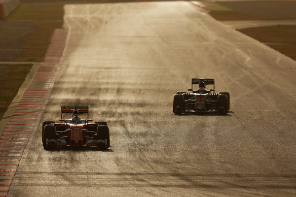Circuit de Catalunya, Barcelona, Spain Monday 22 February 2016. Sebastian Vettel, Ferrari SF16-H. and Jenson Button, McLaren MP4-31 Honda. World Copyright: Sam Bloxham/LAT Photographic ref: Digital Image _SBL5203
