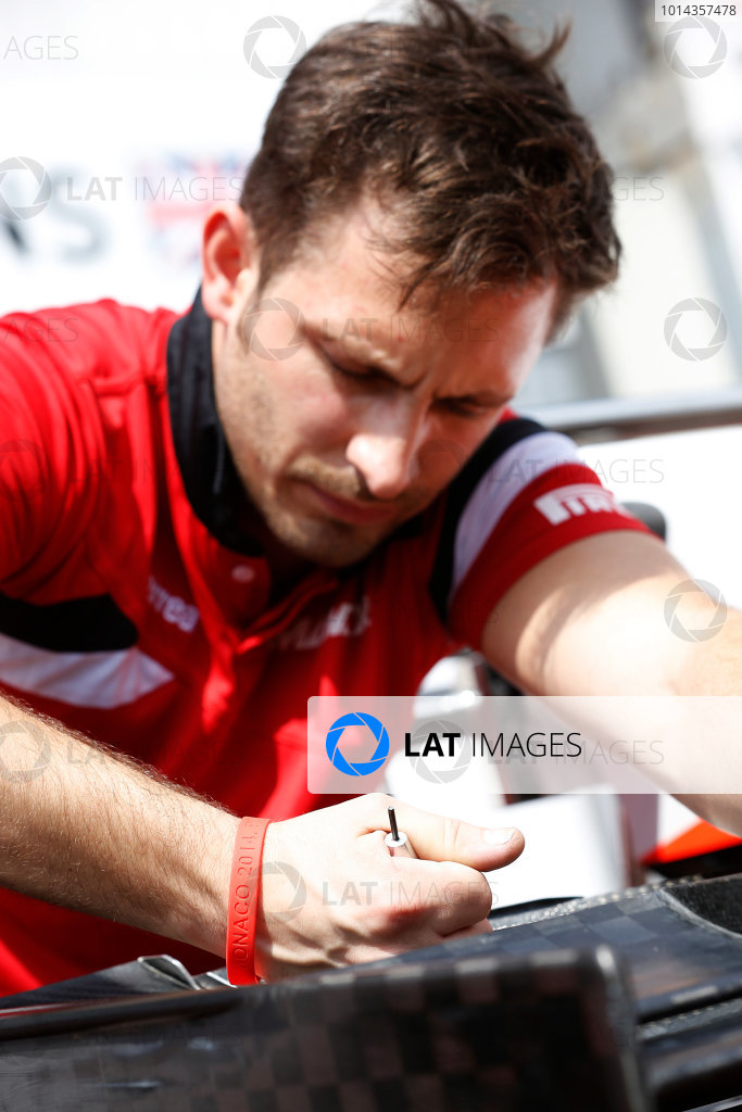 Monte Carlo, Monaco. Wednesday 20 May 2015. A Manor employee wears a commemorative wristaband for Jules Bianchi. World Copyright: Charles Coates/LAT Photographic. ref: Digital Image _J5R6204