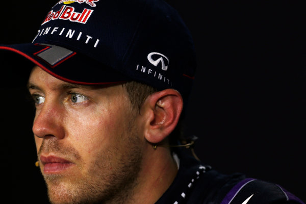 Marina Bay Circuit, Singapore. Sunday 22nd September 2013.  Sebastian Vettel, Red Bull Racing, in the post race press conference.  World Copyright: Charles Coates/LAT Photographic. ref: Digital Image _N7T8160