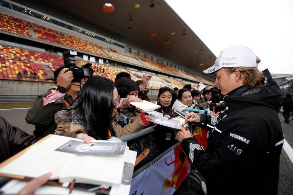 Shanghai International Circuit, Shanghai, China15th April 2010Nico Rosberg, Mercedes GP W01, signs some autographs for fans. Portrait. Atmosphere. World Copyright: Glenn Dunbar/LAT Photographicref: Digital Image GD5D1524