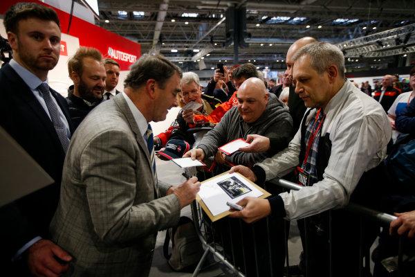 Autosport International Exhibition. National Exhibition Centre, Birmingham, UK. Sunday 14th January 2018. Nigel Mansell signs autographs for fans.World Copyright: Joe Portlock/LAT Images Ref: _L5R0572