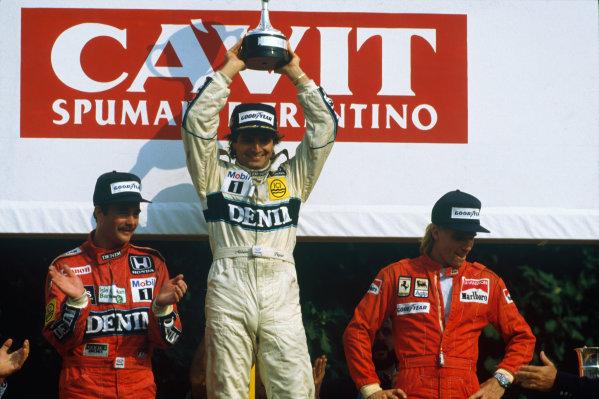 Monza, Italy. 5-7 September 1986. Nelson Piquet, 1st position, Nigel Mansell, 2nd position (both Williams Honda) and Stefan Johansson (Ferrari) 3rd position on the podium. Ref: 86 ITA 01. World Copyright - LAT Photographic