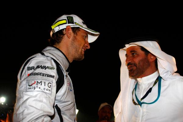 Yas Marina Circuit, Abu Dhabi, United Arab Emirates1st November 2009.Jenson Button, Brawn GP BGP001 Mercedes, 3rd position, with Mohammed Bin Sulayem. Portrait. VIPs.World Copyright: Charles Coates/LAT Photographic ref: Digital Image _26Y3176