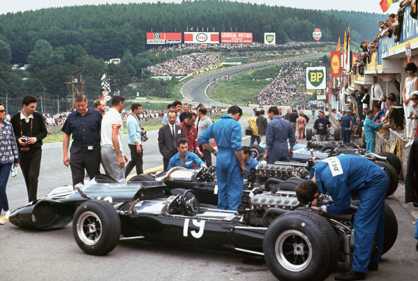 Spa-Francorchamps, Belgium. 12 June 1966.  Mechanics work on Cooper T81 Maseratis in the pits including the number 19 of Jochen Rindt.  Ref: 66BEL01. World Copyright: LAT Photographic