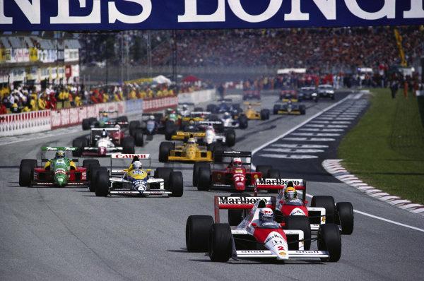 Alain Prost, McLaren MP4-5 Honda, leads teammate Ayrton Senna, at the restart.