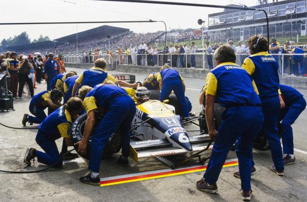 Nelson Piquet, Williams FW11 Honda, makes a pitstop.