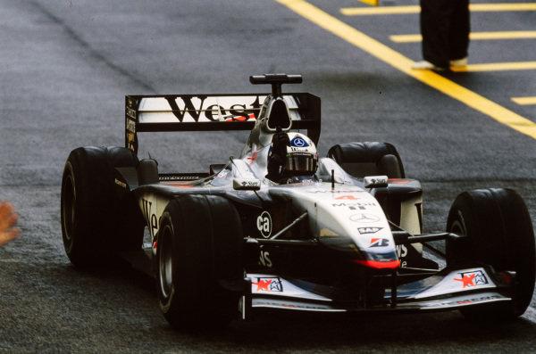 David Coulthard, McLaren MP4-16 Mercedes, celebrates victory.