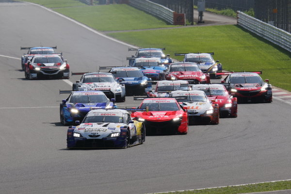 The GT500 Start of the race action. Ryo Hirakawa & Nick Cassidy, KeePer TOM'S GR Toyota Supra leads the field