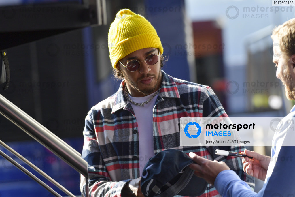 Lewis Hamilton, Mercedes AMG F1, signs an autograph for a fan