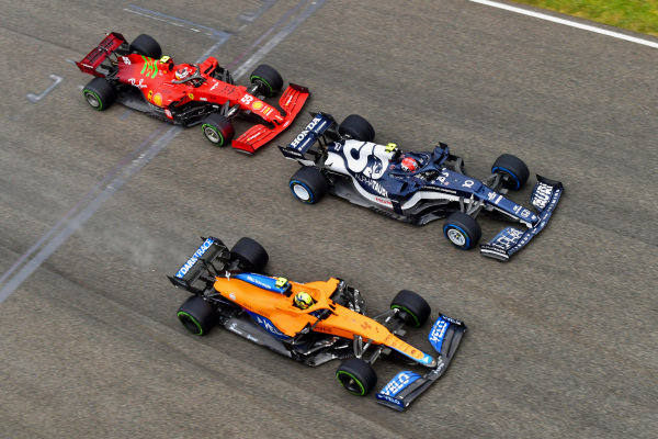 Pierre Gasly, AlphaTauri AT02, leads Lando Norris, McLaren MCL35M, and Carlos Sainz, Ferrari SF21, at the start