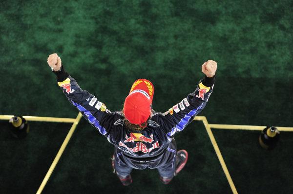 Race winner and 2010 World Champion Sebastian Vettel (GER) Red Bull Racing celebrates on the podium. Formula One World Championship, Rd 19, Abu Dhabi Grand Prix, Race, Yas Marina Circuit, Abu Dhabi, UAE, Sunday 14 November 2010.  BEST IMAGE