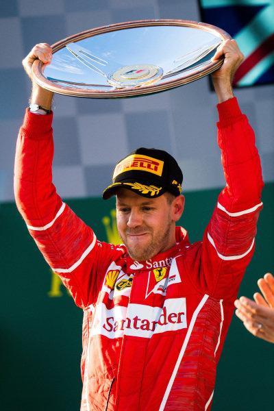 Race winner Sebastian Vettel (GER) Ferrari celebrates on the podium with the toprhy at Formula One World Championship, Rd1, Australian Grand Prix, Race, Albert Park, Melbourne, Australia, Sunday 26 March 2017. BEST IMAGE