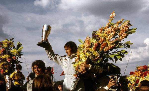The podium (L to R): Francois Cevert (FRA) Tyrrell second; Jackie Stewart (GBR) Tyrrell winner; Emerson Fittipaldi (BRA) Lotus third.  Formula One World Championship, Rd5, Belgian Grand Prix, Zolder, Belgium, 20 May 1973. BEST IMAGE
