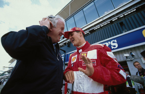 Michael Schumacher, Ferrari with Charlie Whiting, FIA Race Director.