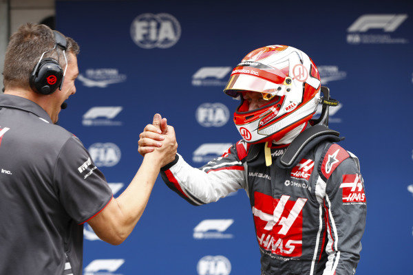 Kevin Magnussen, Haas F1 Team, celebrates after qualifying with a team member.