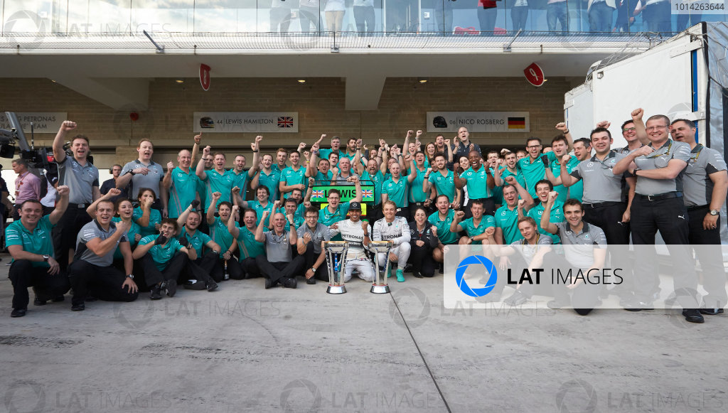 Circuit of the Americas, Austin, Texas, United States of America. Sunday 2 November 2014. Lewis Hamilton, Mercedes AMG celebrates with the team and Nico Rosberg, Mercedes AMG after winning the race. World Copyright: Steve Etherington/LAT Photographic. ref: Digital Image SNE10544