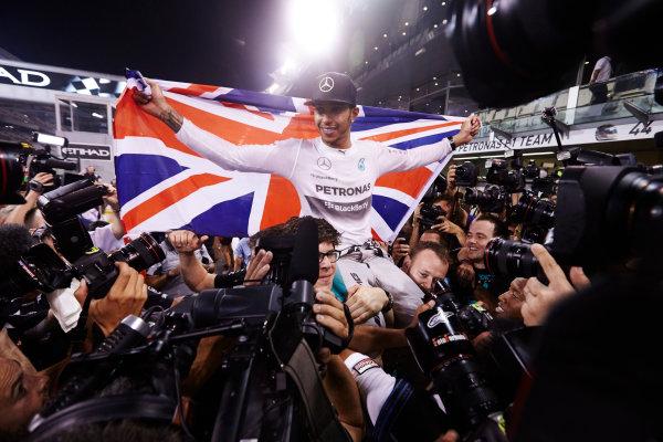 Yas Marina Circuit, Abu Dhabi, United Arab Emirates. Sunday 23 November 2014.  Lewis Hamilton, Mercedes AMG, celebrates championship victory.  World Copyright: Steve Etherington/LAT Photographic. ref: Digital Image SNE13424