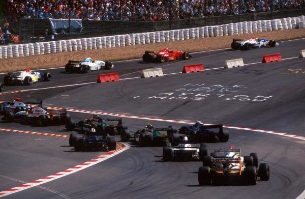 The field make their way through a temporary chicane inserted to tame the legendary Eau Rouge. Thankfully safety improvements allowed the corner to return to its former glory the following season. The chicane contains a personal tribute from a fan to the late Ayrton Senna (BRA).