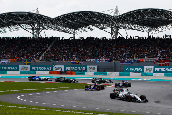 Sepang International Circuit, Sepang, Malaysia. Sunday 1 October 2017. Lance Stroll, Williams FW40 Mercedes, leads Carlos Sainz Jr, Toro Rosso STR12 Renault, and Pierre Gasly, Toro Roso STR12 Renault, on the formation lap. World Copyright: Joe Portlock/LAT Images  ref: Digital Image _L5R7846