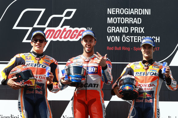 2017 MotoGP Championship - Round 11 Spielberg, Austria Sunday 13 August 2017 Podium: second place Marc Marquez, Repsol Honda Team, Race winner Andrea Dovizioso, Ducati Team, third place Dani Pedrosa, Repsol Honda Team World Copyright: Gold and Goose / LAT Images ref: Digital Image 686853