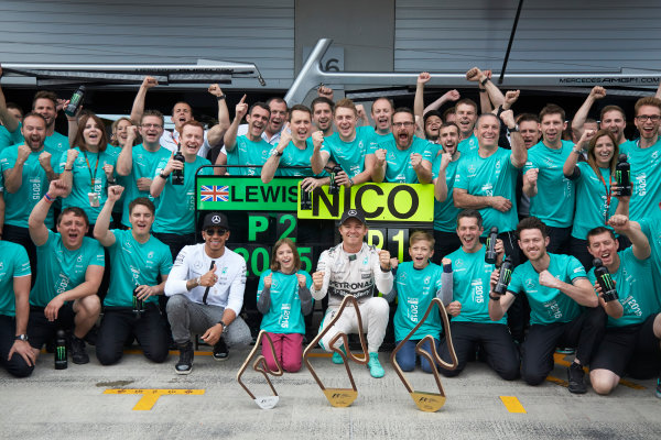 Red Bull Ring, Spielberg, Austria. Sunday 21 June 2015. Nico Rosberg, Mercedes AMG, 1st Position, and Lewis Hamilton, Mercedes AMG, 2nd Position, celebrate with the Mercedes AMG team. World Copyright: Steve Etherington/LAT Photographic. ref: Digital Image SNE14866
