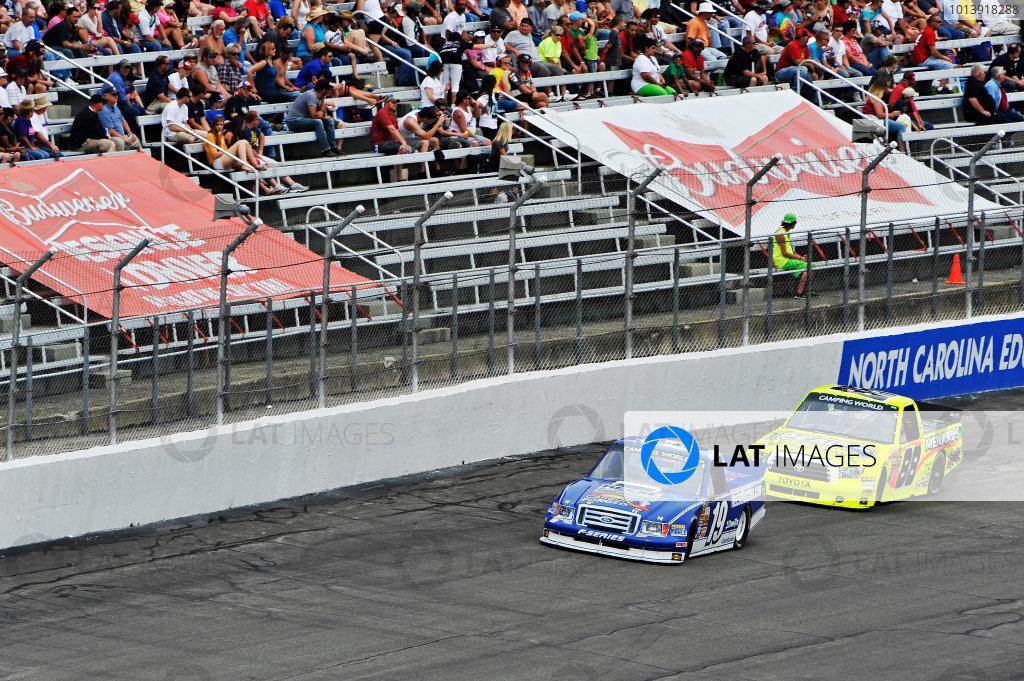 13-14 April, 2013, Rockingham, North Carolina USA Joey Logano, Matt Crafton ©2013, Scott R LePage LAT Photo USA
