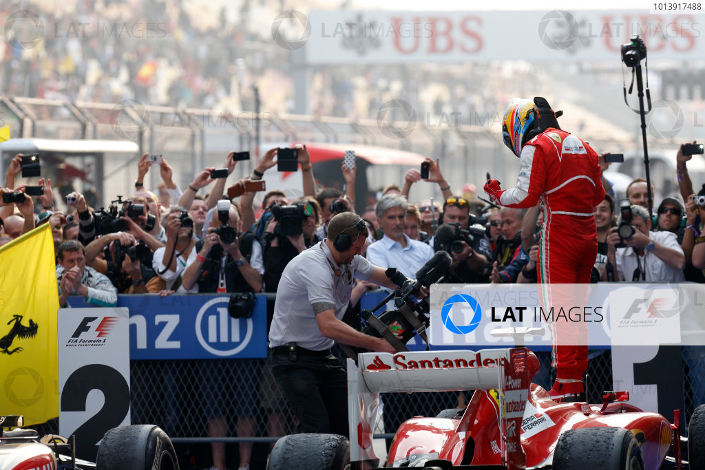 Shanghai International Circuit, Shanghai, China Sunday 14th April 2013 Fernando Alonso, Ferrari, 1st position, celebrate victory on arrival in Parc Ferme. World Copyright: Alastair Staley/LAT Photographic ref: Digital Image _R6T2345
