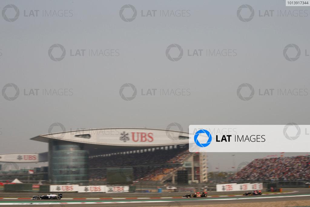 Shanghai International Circuit, Shanghai, China Sunday 14th April 2013 Valtteri Bottas, Williams FW35 Renault, leads Romain Grosjean, Lotus E21 Renault, and Mark Webber, Red Bull RB9 Renault.  World Copyright: Glenn Dunbar/LAT Photographic ref: Digital Image _89P8293