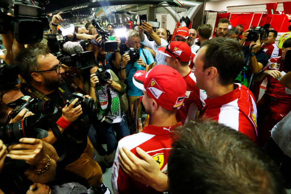Marina Bay Circuit, Singapore. Sunday 20 September 2015. Sebastian Vettel, Ferrari, 1st Position, Kimi Raikkonen, Ferrari, 3rd Position, and the Ferrari team celebrate a double podium result. World Copyright: Alastair Staley/LAT Photographic ref: Digital Image _R6T7598