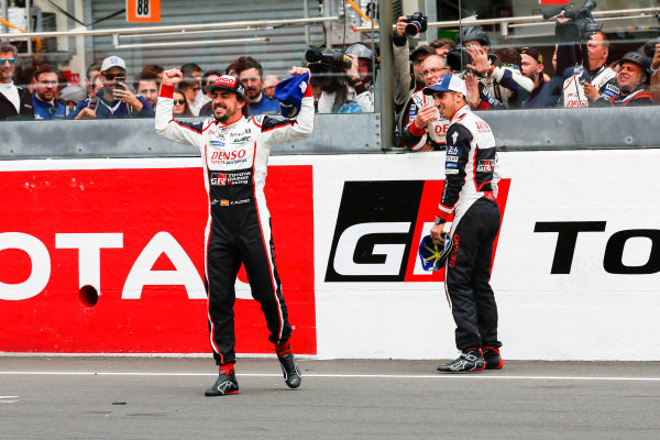 Fernando Alonso, Toyota Gazoo Racing, and Sébastien Buemi, Toyota Gazoo Racing, celebrate winning Le Mans 2018