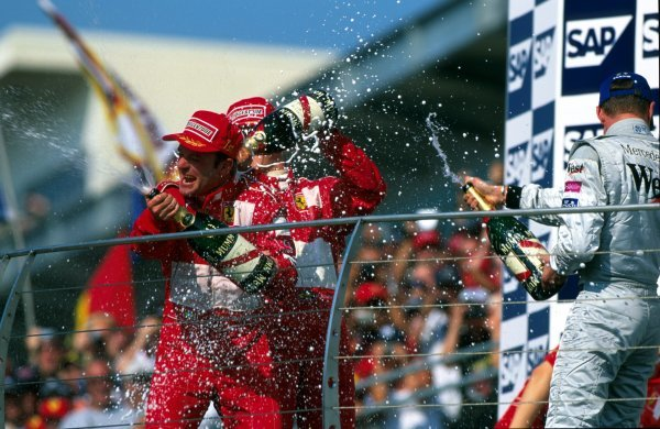 Rubens Barrichello (BRA) Ferrari, left, took an unexpected win after Michael Schumacher (GER) Ferrari, centre, tried to orchestrate a dead heat but failed. David Coulthard (GBR) McLaren, right, finished third.