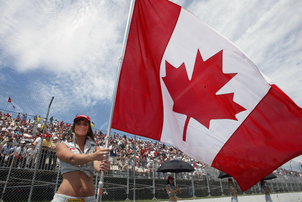 2004 Canadian Grand Prix - Sunday Race,2004 Canadian Grand Prix Montreal, Canada. 13th June 2004 A grid girl waves the Canadian Flag before the race start.World Copyright: Steve Etherington/LAT Photographic ref: Digital Image Only
