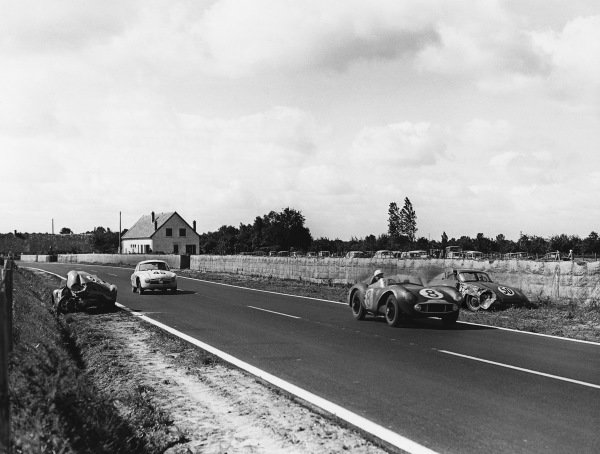 Le Mans, France. 28th - 29th July 1956 Stirling Moss/Peter Collins (Aston Martin DB3S), 2nd position, leads Jean-Claude Vidilles/Jean Thepenier (D B. HBR Panhard), 11th position, action. World Copyright: LAT Photographic Ref: Autocar Used Pic 3rd August 1956 Pg 153.