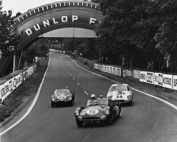 Le Mans, France. 10th - 11th June 1961 Jim Clark/Ron Flockhart (Aston Martin DBR1/30), retired, leads David Cunningham/Ed Hugus (Osca S1000), retired and Bill Allen/Trevor Taylor (Lotus Elite), 12th position, action. World Copyright: LAT Photographic Ref:  Autocar Used Pic 16th June 1961 Pg 960.