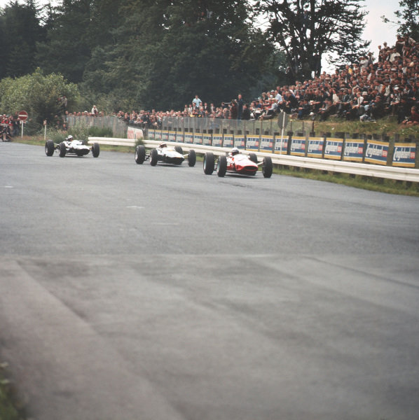 Nurburgring, Germany.30/7-1/8 1965.Lorenzo Bandini (Ferrari 158) leads Mike Spence (Lotus 33 Climax) and Jochen Rindt (Cooper T77 Climax). Rindt and Bandini finished in 4th and 6th positions respectively.Ref-3/1823.World Copyright - LAT Photographic