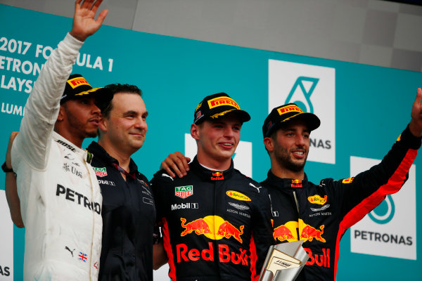 Sepang International Circuit, Sepang, Malaysia. Sunday 01 October 2017. Lewis Hamilton, Mercedes AMG, winner Max Verstappen, Red Bull Racing and Daniel Ricciardo, Red Bull Racing wave on the podium. World Copyright: Andy Hone/LAT Images  ref: Digital Image _ONY5377