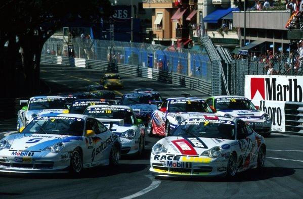 Marcel Tiemann (MON) and Christophe Bouchut (FRA) go side by side through Sainte Devote.Porsche Supercup, Rd4, Monte-Carlo, Monaco. 26 May 2002.BEST IMAGE