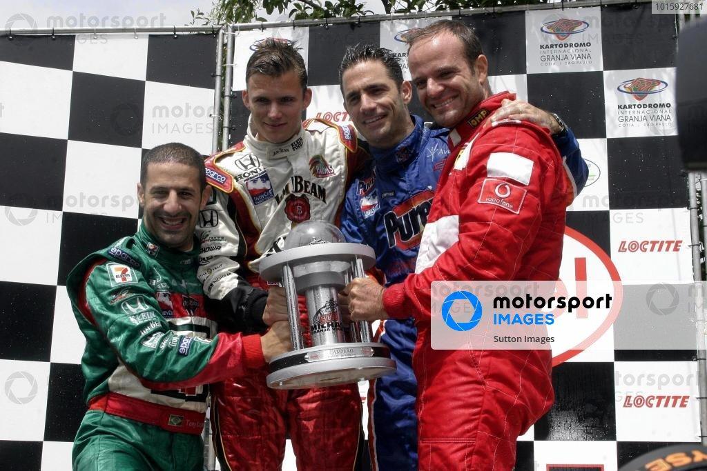 The winning team (L to R): Tony Kanaan (BRA), Dan Wheldon (GBR), Felipe Giaffone (BRA) and Rubens Barrichello (BRA) on the podium. Granja Viana 500 Kart Race, Sao Paulo, Brazil, 14 November 2004. DIGITAL IMAGE