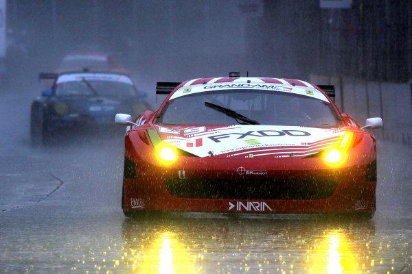 1-2 June, 2012, Detroit, Michigan, USAThe #69 Ferrari of Jeff Segal and Emil Assentato races in the rain during practice.(c)2012, R D. EthanLAT Photo USA