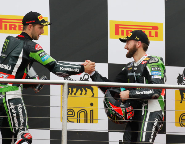 2015 World Superbike Championship.  Donington Park, UK.  23rd - 24th May 2015.  Tom Sykes, Kawasaki, 1st position, and Jonathan Rea, Kawasaki, 2nd position, celebrate on the podium.  Ref: KW7_6277a. World copyright: Kevin Wood/LAT Photographic
