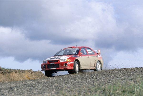 1999 World Rally Championship.New Zealand Rally, New Zealand. 16-18 July 1999.Tommi Makinen/Risto Mannisenmaki (Mitsubishi Lancer Evo6), 1st position.World Copyright: McKlein/LAT PhotographicRef: 35mm transparency 99RALLY09